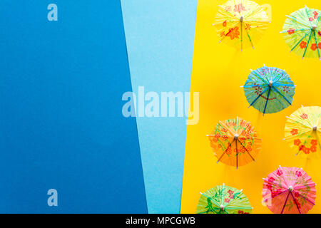 Overhead view on beach with umbrellas and sea with boats. Sea travel and summer vacation minimal concept. Paper origami composition. Flat lay. Top vie - Stock Photo