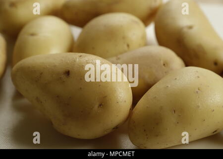 Close up of unpeeled new potatoes - Stock Photo