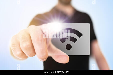 wireless technology concept with man touching wifi icon on translucent screen interface - Stock Photo