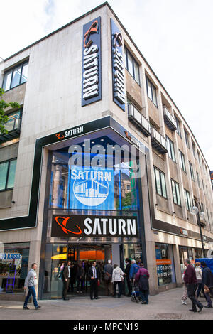 Germany, Cologne, the electronics store Saturn on the shopping street Hohe Strasse.  Deutschland, Koeln, der Elektrofachmarkt Saturn in der Fussgaenge - Stock Photo