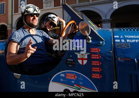 Modena, Italy. 21th, May 2016.  (L-R)  Juan Tonconogy and Barbara Ruffini from Argentina, with their model car Bugatti 40 (1927), partecipate in the r - Stock Photo