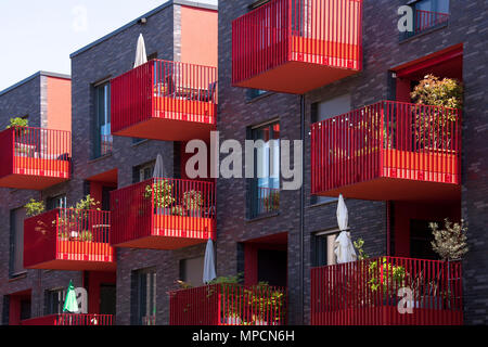 Germany, Cologne, red balconies of the apartment building Clouth 3 in the Clouth quarter in the district Nippes, Kister Scheithauer Gross Architects.  - Stock Photo