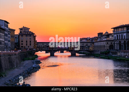 Sunset at Ponte Vecchio (Old Bridge) over the river Arno in Florence, Italy - Stock Photo