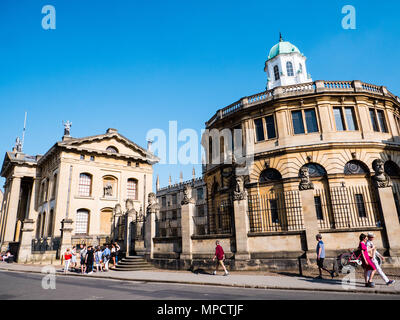 Tourists outside, Clarendon Building, and The Sheldonian Theatre, University of Oxford, Oxfordshire, UK, England, UK, GB. - Stock Photo