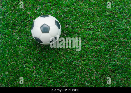 Table top view aerial image soccer or football season background.Flat lay object ball on the artificial green grass wallpaper.Free space for creative  - Stock Photo