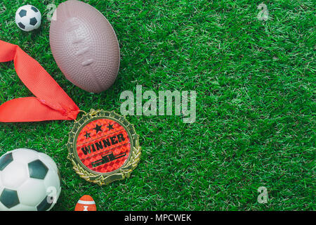 Table top view aerial image soccer or football tournament season background.Flat lay ball with accessories decorations items on the artificial green g - Stock Photo