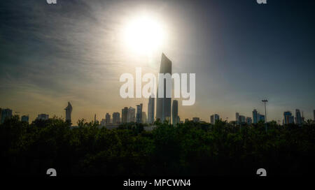Cityscape of the Kuwait city under the sun in Kuwait - Stock Photo