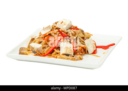 Chinese noodles with tofu and vegetables on a square plate isolated from background - Stock Photo