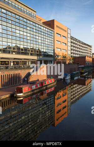 Modern buildings in Birmingham city centre with canal and boats - Stock Photo