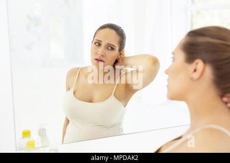 Unhappy attractive woman feeling exhaustion - Stock Photo