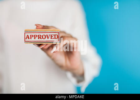 Woman holding Approved stamp - Stock Photo