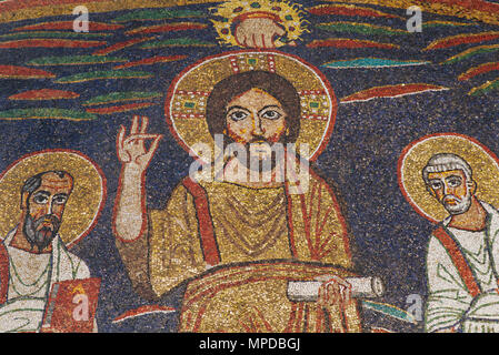 Detail of the 9th century mosaic depicting the Redeemer with Saints Paul and Peter and the Hand of God - Basilica of Santa Cecilia in Trastevere - Stock Photo