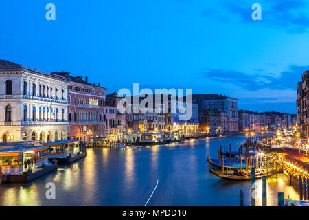 Night scene, twilight, dusk,  at blue hour with lights and reflections Grand Canal, Venice, Veneto, Italy from the Rialto Bridge - Stock Photo