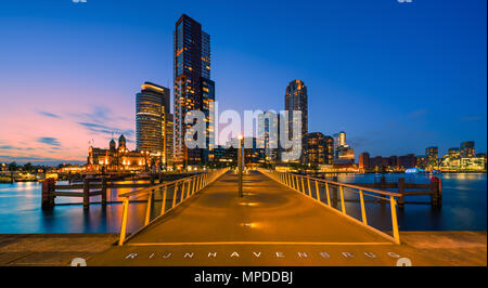Downtown Rotterdam at twilight with a small part of it's skyline as seen from the Rijnhavenbrug with the view to the Kop van Zuid, Rotterdam, Nether - Stock Photo