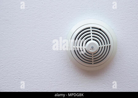 Smoke detector fire alarm on celling - Stock Photo