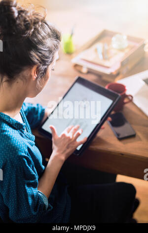 View from above. A woman using a digital tablet  - Stock Photo