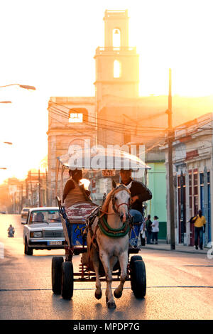 A horse-drawn taxi carriage early in the morning, Cienfuegos, Cuba, Caribbean - Stock Photo