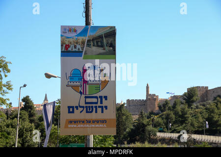 Jerusalem, Israel - May 16, 2018: View of a tourist billboard with the Jaffa Gate in the background, the entrance to the Old City of Jerusalem, Israel - Stock Photo