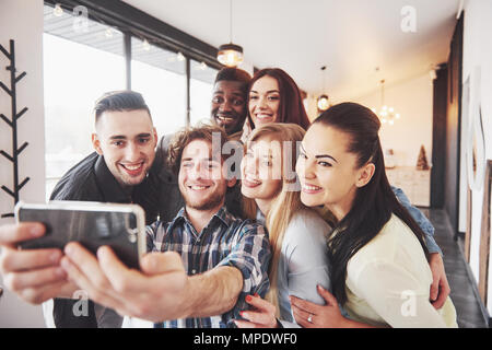 Group portrait of Cheerful old friends communicate with each other, friend posing on cafe, Urban style people having fun, Concepts about youth togetherness lifestyle. Wifi connected - Stock Photo
