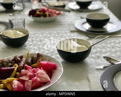 Turkish Yogurt with Pickle at Dinner Table. Traditional Food. - Stock Photo