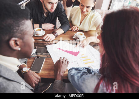 Startup Diversity Teamwork Brainstorming Meeting Concept. Business Team Coworkers Sharing World Economy Report Document Laptop.People Working Planning Start Up.Group Young Hipsters Discussing Cafe - Stock Photo
