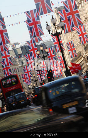Union Jack Flags in the breeze along Regent Street in London celebrating the Royal wedding of Prince William and Catherine Middleton on the 29th April 2011 at Westminster Abbey London UK - Stock Photo