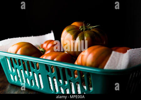 Raw Organic Red and Brown Heirloom Tomatoes. Organic Food. - Stock Photo