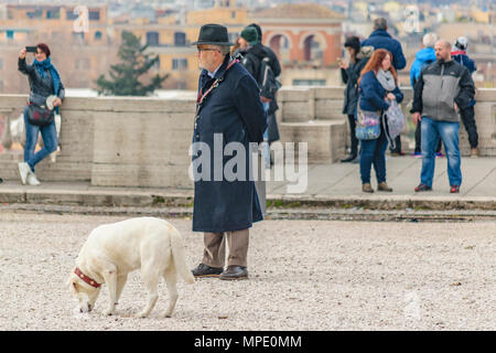 ROME, ITALY, DECEMBER - 2017 - Group of tourist watching and taking photos of Rome cityscape from monte pincio viewpoint. - Stock Photo
