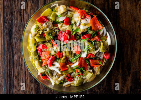 Eggplant salad with red pepper on wooden surface. Organic Food. - Stock Photo