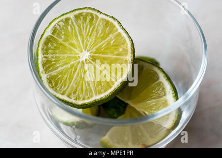 Fresh Lime Slices in Glass Cup. Organic Food. - Stock Photo