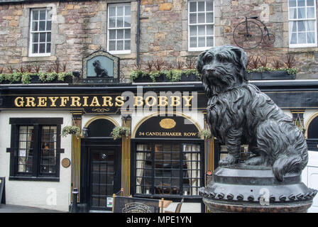 Statue of Greyfriars Bobby outside the inn of the same name, Edinburgh, Scotland - Stock Photo