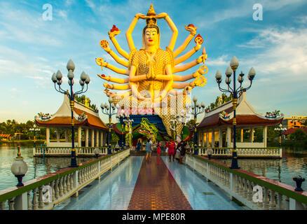 Wat Plai Laem Buddhism Temple statues during a sunste in Koh Samui, Surat Thani, Thailand - Stock Photo