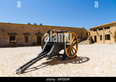 Free outdoor exhibit of old artillery defence weapons at San Carlos casttle open military museum, Palma, Mallorca - Stock Photo