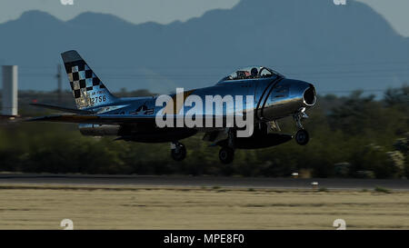 An F-86 Sabre takes off during the 2017 Heritage Flight Training and Certification Course at Davis-Monthan Air Force Base, Ariz., Feb. 10, 2017. The first production model of the F-86 flew in 1948 and supported the Strategic Air Command from 1949 to 1950. (U.S. Air Force photo by Senior Airman Chris Drzazgowski) - Stock Photo