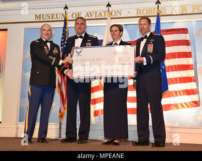 U.S. Air Force General Lori Robinson, commander of North American Aerospace Defense Command and United States Northern Command, along with senior leadership from Team JSTARS, display a check with a donation in her honor to the Museum of Aviation, during the 2016 Annual Awards Banquet at the Museum of Aviation, Robins Air Force Base, Ga., Feb. 10, 2017.  General Robinson was the keynote speaker during the 2016 Team JSTARS Annual Awards Banquet. Team JSTARS is a unique total force integration associate wing comprised of the 116th Air Control Wing, Georgia Air National Guard, 461st Air Control Wi - Stock Photo