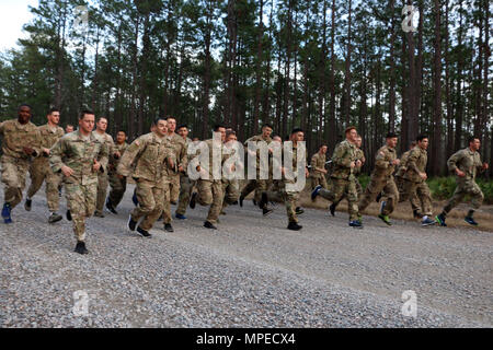 Soldiers of 6th Squadron, 8th Cavalry Regiment, 2nd Infantry Brigade Combat Team, 3rd Infantry Division begin a five-mile run February 8, 2017 at Fort Stewart, Ga. Troopers of 6-8 Cav. participated and hosted a selection to determine who would go on to compete for a spot in this year's biennial Gainey Cup competition. (U.S. Army photo by Sgt. Robert Harris/Released) - Stock Photo