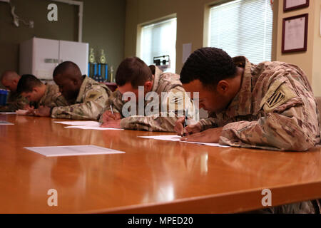 Soldiers of 6th Squadron, 8th Cavalry Regiment, 2nd Infantry Brigade Combat Team, 3rd Infantry Division take a written reconnaissance exam February 8, 2017 at Fort Stewart, Ga. Troopers of 6-8 Cav. participated and hosted a selection to determine who would go on to compete for a spot in this year's biennial Gainey Cup competition. (U.S. Army photo by Sgt. Robert Harris/Released) - Stock Photo
