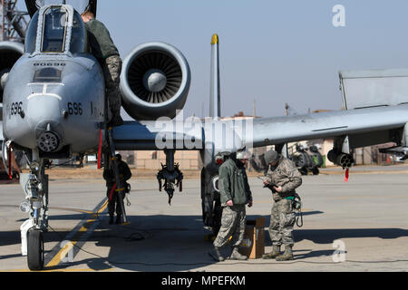 Airmen assigned to the 25th Aircraft Maintenance Unit perform pre-flight checks on an A-10 Thunderbolt II assigned to the 25th Fighter Squadron during Buddy Wing 17-3 at Osan Air Base, Republic of Korea, Feb. 14, 2017. During Buddy Wing 17-3, pilots from the 25th FS and the ROK air force 237th Tactical Control Squadron flew training missions to increase to the two units' ability to work together in a wartime scenario. (U.S. Air Force photo by Staff Sgt. Victor J. Caputo) - Stock Photo