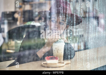 Beautiful girl in cafe - Stock Photo