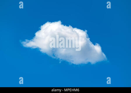 Single white fluffy cloud in the blue sky for weather forecast and climate themes. - Stock Photo