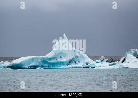 Ice Cap melting glaciers, Snow, ice sheets, glaciers, sea ice and permafrost; A famous tourist location, the Jokulsar glacial lagoon, Iceland, sometimes known as Jokulsarlon, it is one of Icelands's most popular destinations. - Stock Photo