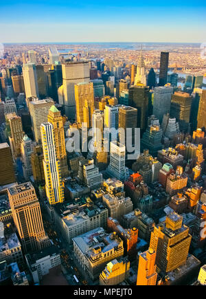 Aerial vertical view over midtown and east side from Empire State building top, Manhattan, New York. Sunset of a clean, sunny day with exceptional vis - Stock Photo