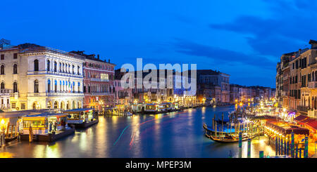 Panorama view from Rialto Bridge of the Grand Canal at dusk  during Blue Hour, twilight, with lights reflected in the water, Venice, Veneto, Italy. Lo - Stock Photo