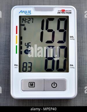 Upper Arm Digital Blood Pressure Monitor 159/80 mmHg - Stock Photo