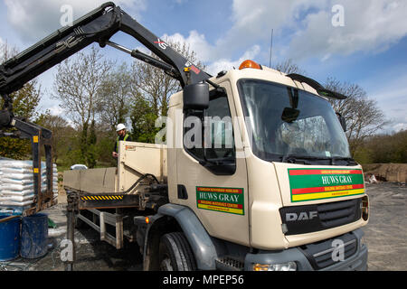 A Huws Gray builders merchant lorry delivering building products - Stock Photo