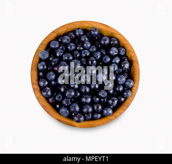 Bilberries in a wooden bowl. Top view. Ripe and tasty blueberries isolated on white background. - Stock Photo