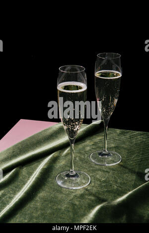 A flute filled with Prosecco, an italian white sparkling wine cultivated in Valdobbiadene. Pop colorful background - Stock Photo