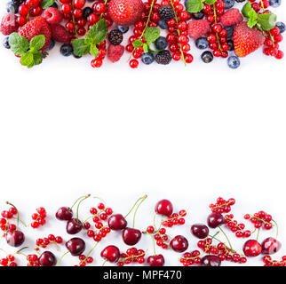 Red and black-blue fruits and berries. Ripe red currants, strawberries, raspberries, blackberries, blueberries, cherries and blackcurrants on white ba - Stock Photo