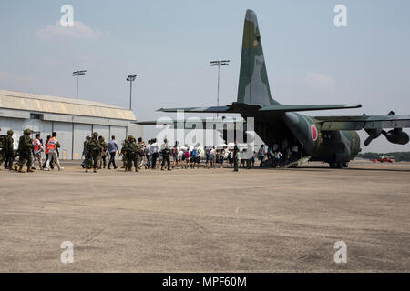 Japanese Self-Defense Force (JSDF) service members escort Japanese citizens onto a JSDF C-130 aircraft during a noncombatant evacuation operation exercise during Cobra Gold 2017 at Utapao International Airport in Rayong Province, Thailand, Feb. 19, 2017. Cobra Gold, in its 36th iteration, focuses on humanitarian civic action, community engagement,  and medical activities to support the needs and humanitarian interest of civilian populations around the region. (U.S. Marine Corps photo by Lance Cpl. Daniel R. Betancourt Jr.) - Stock Photo
