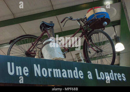 An old bicycle or push bike on display as an advertising feature for une normande a London's cheese and delicatessen produce stall on borough market. - Stock Photo